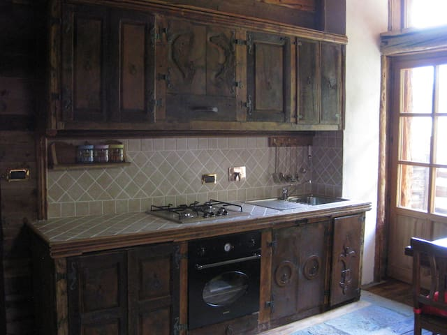 Kitchen with dishwasher refrigerator, oven cookware, dishes and silverware, cups