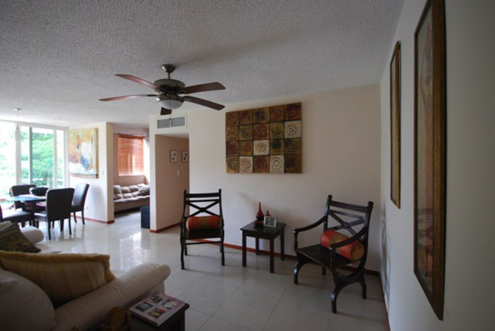 Living Room. Enjoy central a/c, ceiling fans or the fresh Pacific breezes.