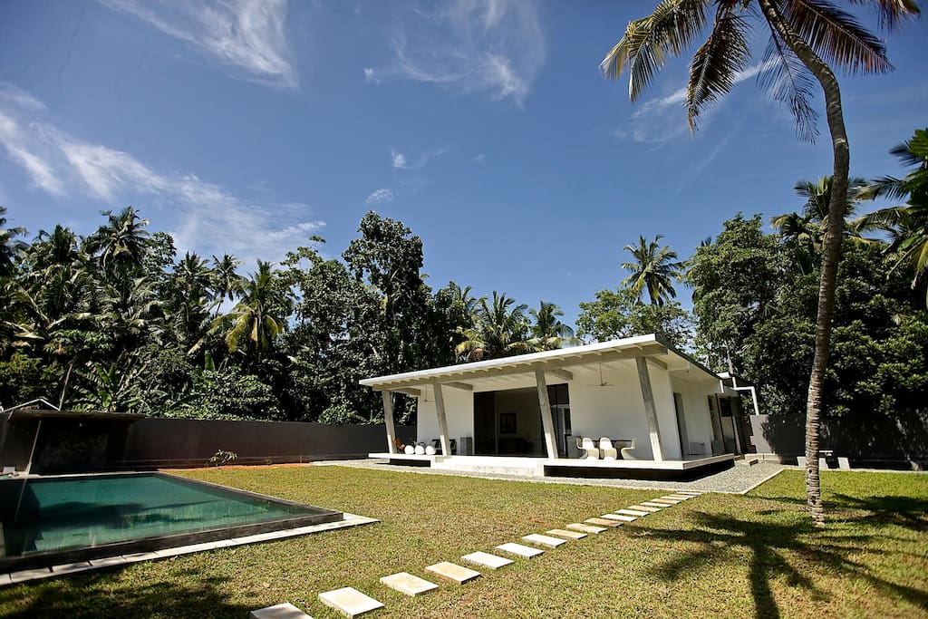 Large 1 acre lawned garden with coconut and mango trees.