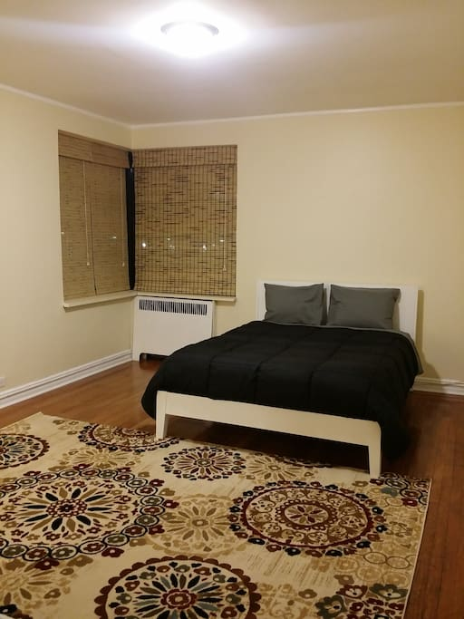 This enormous bedroom has huge windows with lots of natural light, a new queen size bedroom set, two sizable closets for your clothes and belongings, and free Wi-Fi with high speed internet throughout the entire apartment.
