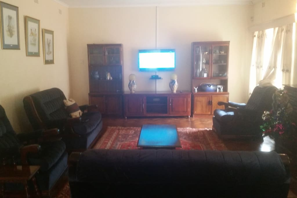 multiple channel  TV in spacious entertainment room