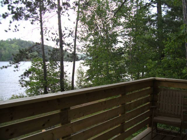 Enjoy the deck view overlooking Trout Lake.