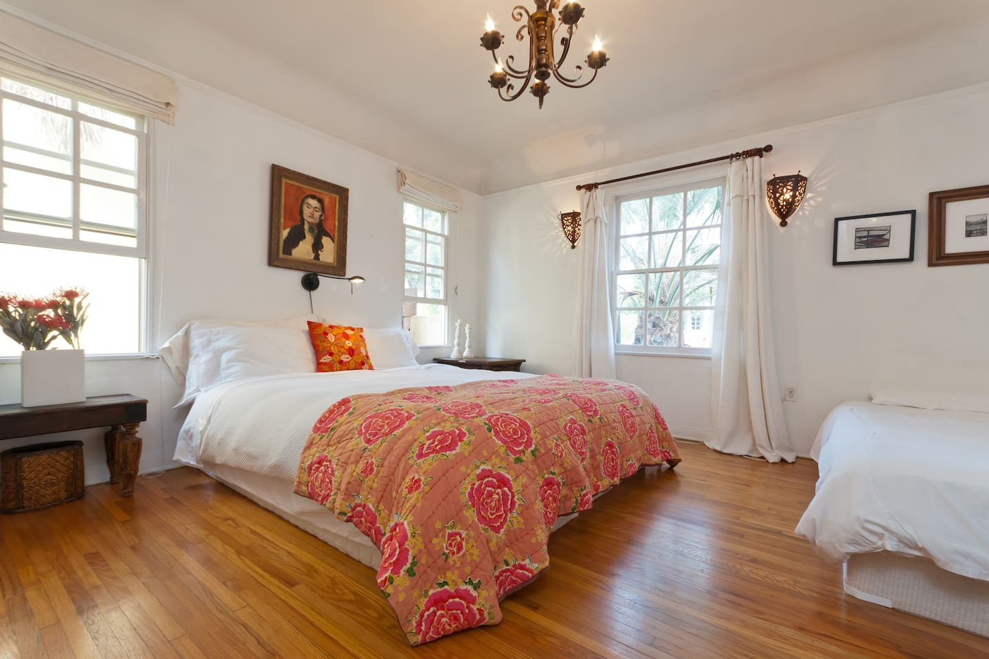 Spanish room with california king bed and twin bed