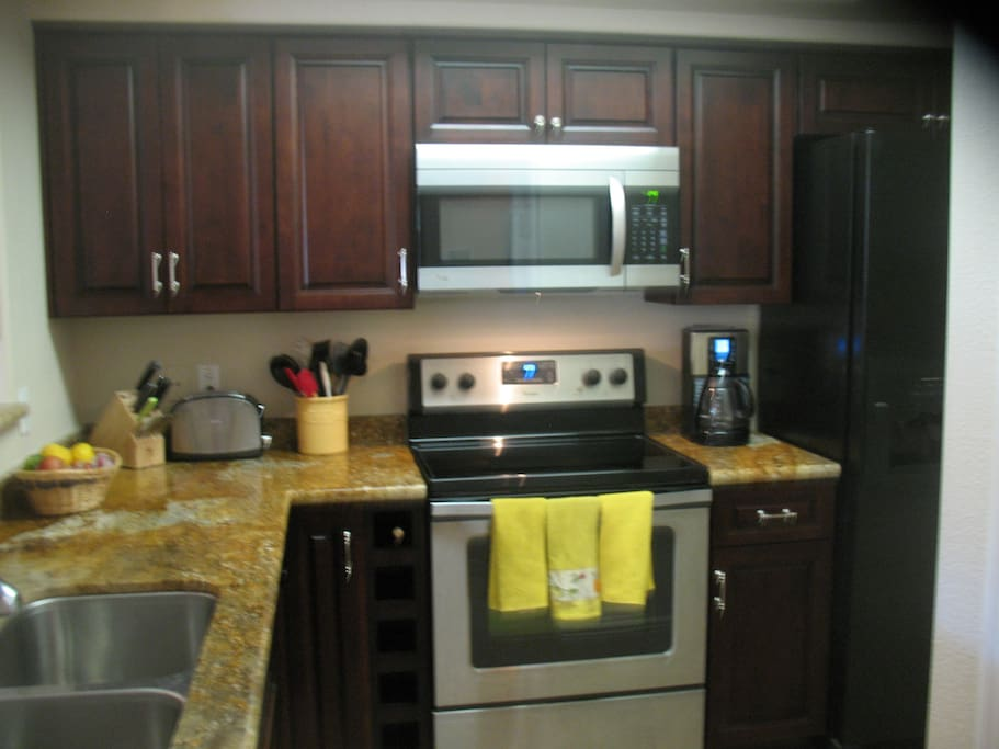 Kitchen has granite counter tops and is fully equipped.