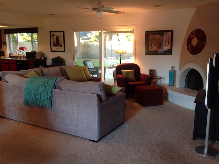 Great room with view of lush backyard - sliding glass doors go out to covered patio - pool area