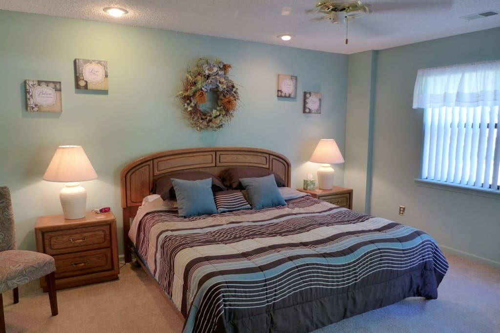 Master Suite with King Bed, and private entrance to private covered patio.