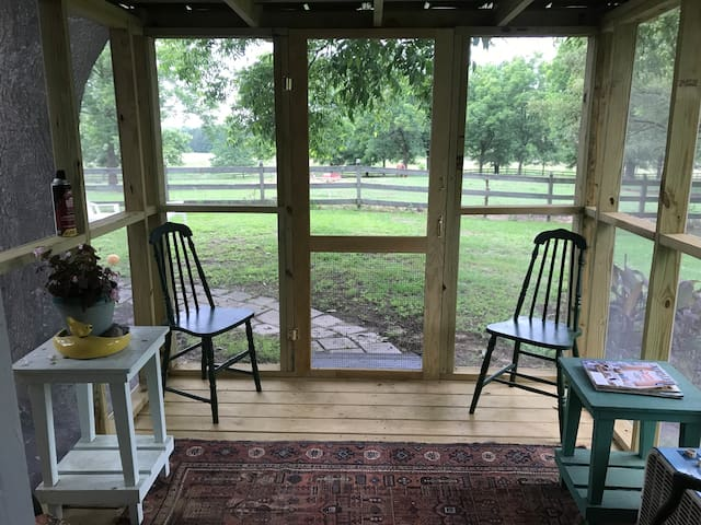 Small screened porch overlooking pasture.