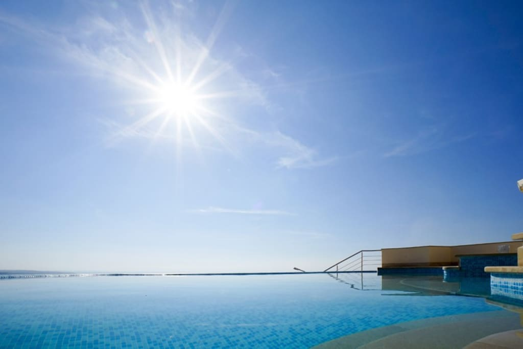 The stunning infinity pool with views of the Mediterranean beyond.