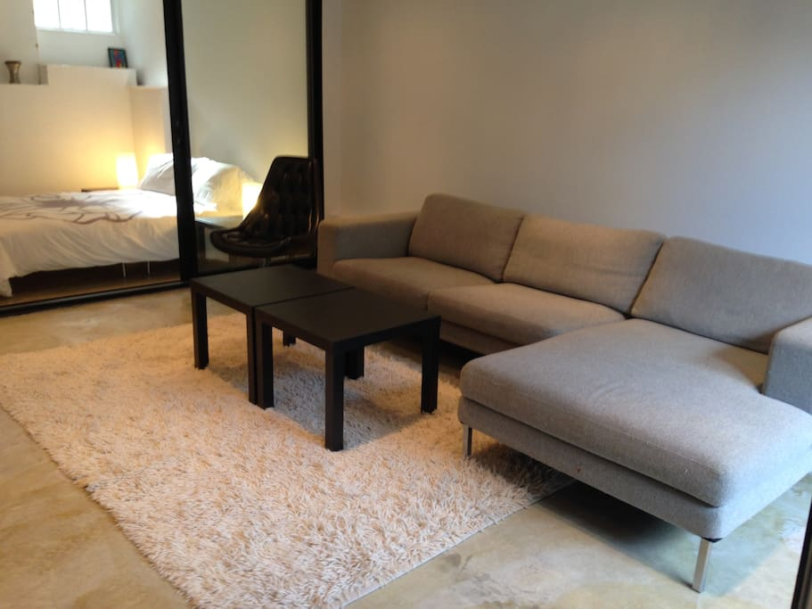 Living area with large sectional sofa.
