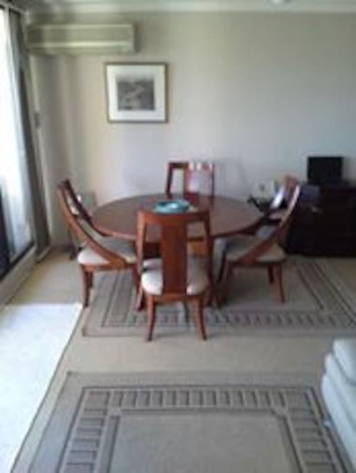 The spacious dining area has a quality dining setting for up to 4 persons.