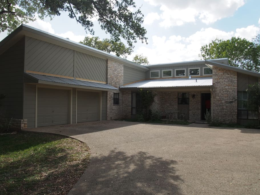 A large 3 bedroom 2 1/2 bath home with large covered porch overlooking pool and Cypress Creek.