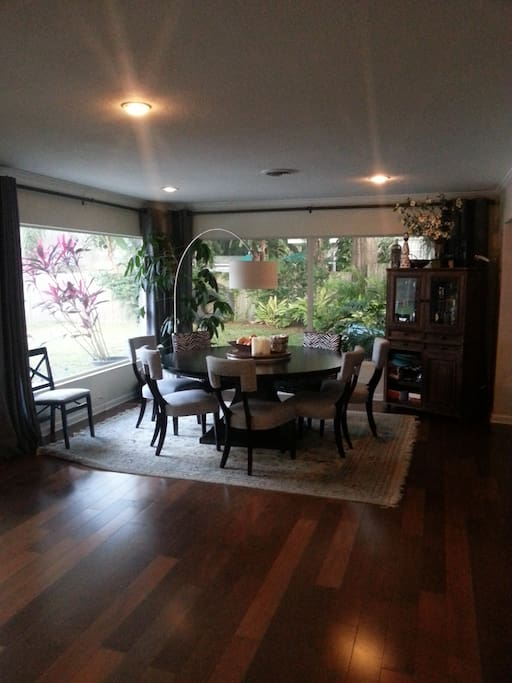 Large dining room table seats up to 10 people with large lazy susan in the middle.