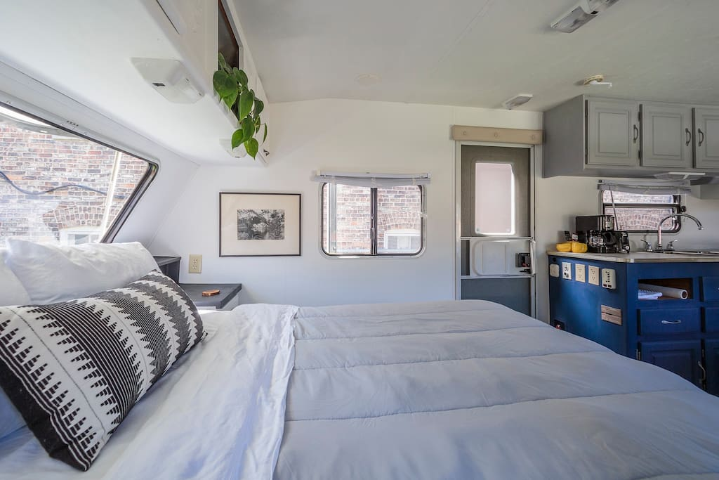 Queen bed in our cozy camper. Follow us at @bunksandbreakfast
