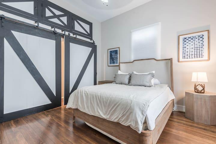 Master bedroom with large sliding door walk in closet