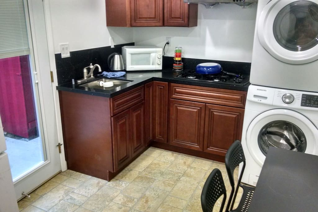 Private kitchen with washer/dryer, refrigerator, microwave, electric water kettle, cooktop, hood exhaust and expandable dining table