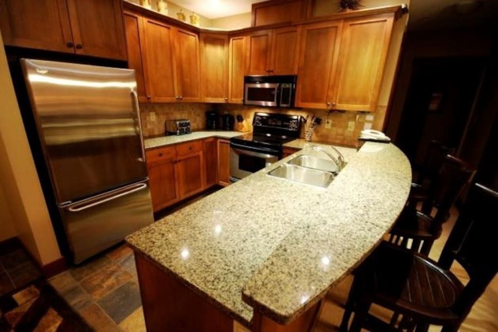The kitchen boasts excellent appliances and a beautiful kitchen island