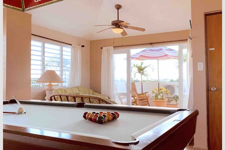 Beach PH with private outdoor terrace, game room.