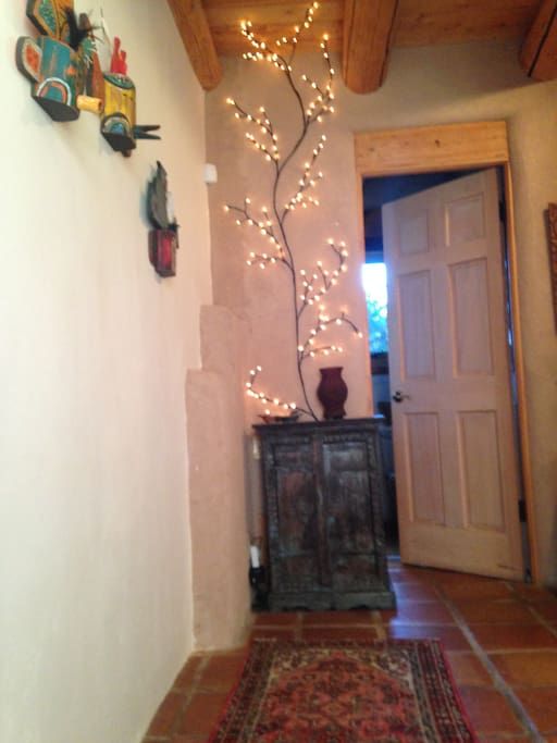 Entry area at Casa Contenta with welcoming lighting.
