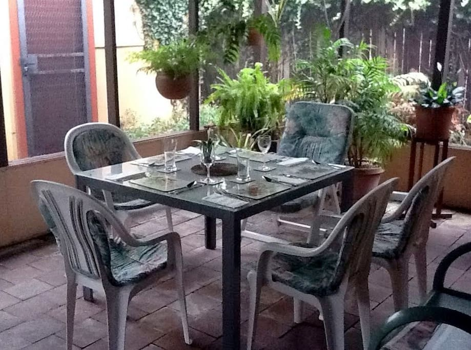 Since 2015 this dining set-up has been in screened area.