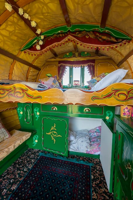 A traditional Romany double bed and space for 2 little ones in the 'cupboard' underneath.  Closing the door is optional!!