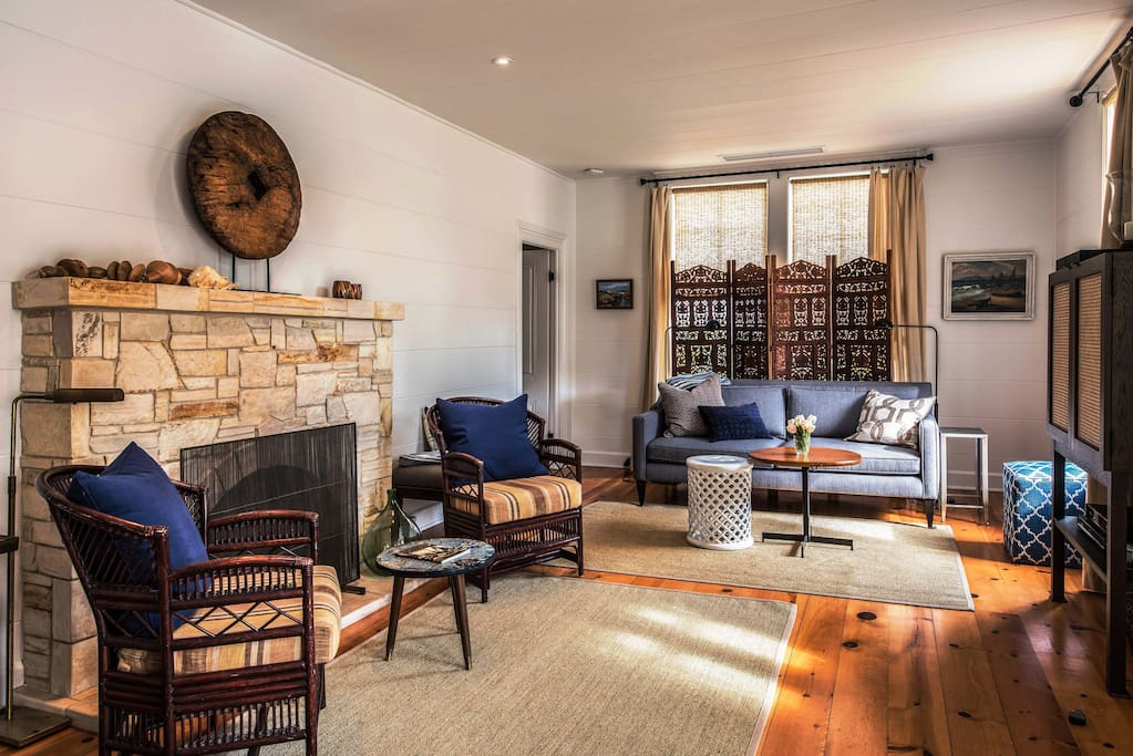 """The living room has a Carmel Stone gas fireplace and a 41"""" HDTV."""