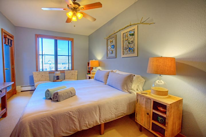 Master bedroom with King memory foam bed and personal TV