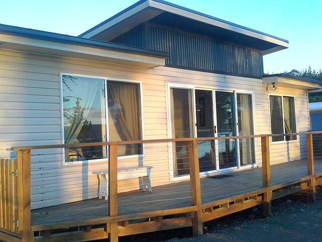 Nebraska four bedroom, two bathroom holiday house. Level access to the beach, just 50 metres across the esplanade!