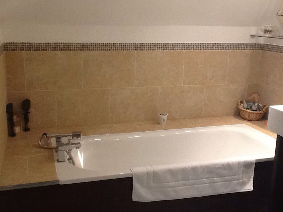 Large bathroom with numerous products.