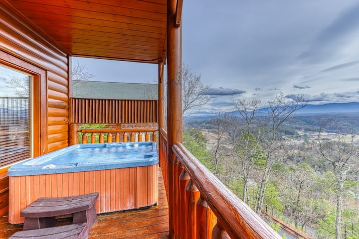 Roomy log cabin with stunning mountain views, private hot tub & shared pool