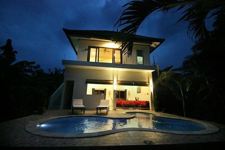 Two story house with a pool in lovina