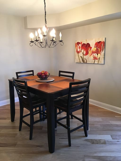 dining area, comes with two more chairs, currently placed at the breakfast bar
