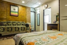 single Diwan bed next to the double bed. Can accommodate one more adult.