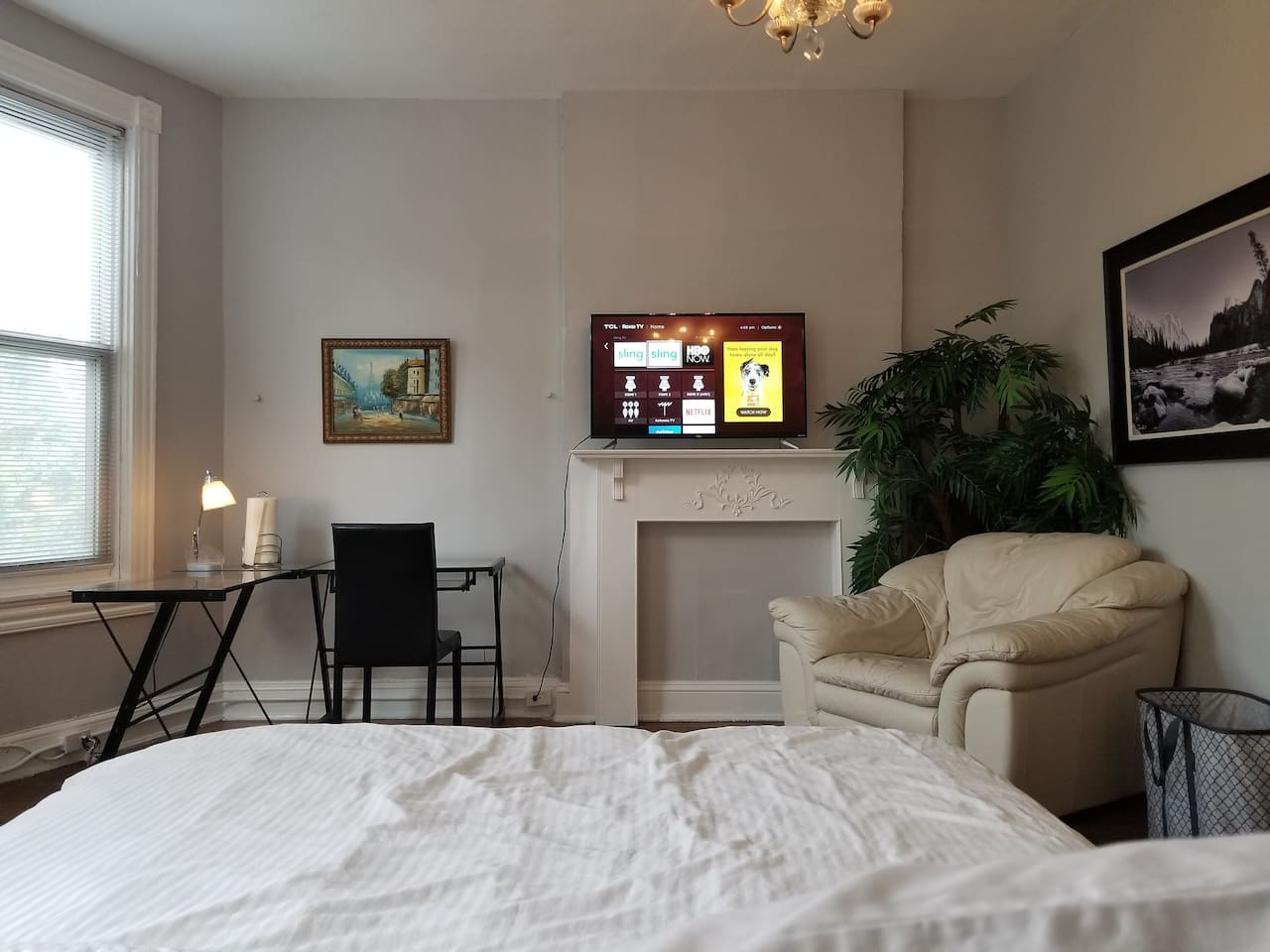 Tastefully furnished and well appointment with a desk, Roku TV and comfortable sofa seat