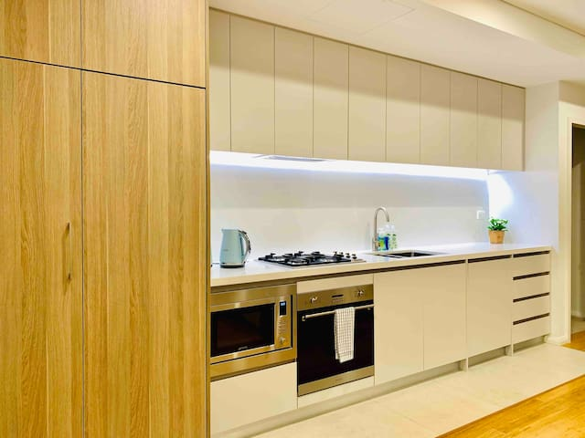 Super modern open plan kitchen with SMEG superior European appliances (Cooktop, range good, dish washer, microwave)