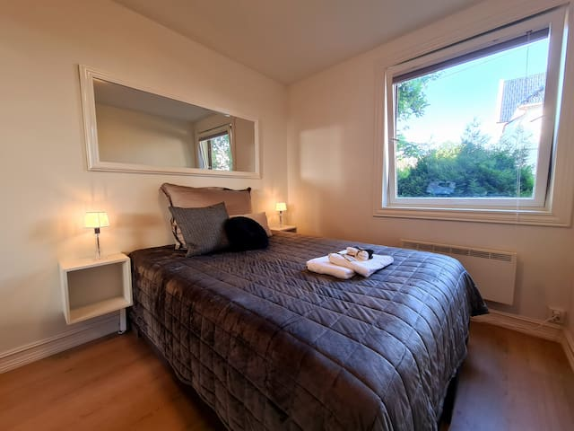 Bedroom nr. 1 has a queen sized bed and wardrobe. The window has blackout curtains so you can enjoy a restful night of sleep.