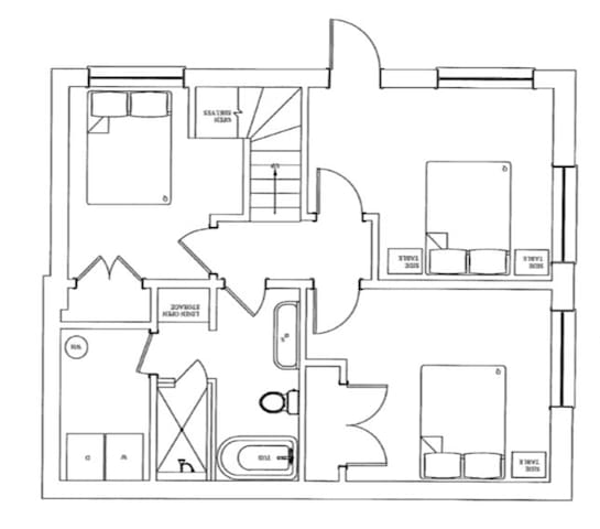Ground level layout with three bedrooms