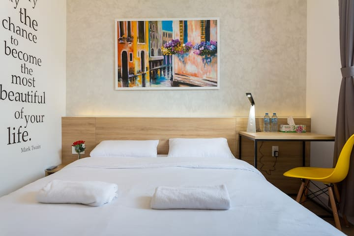 Your room with natural light, queen size bed, working desk, wardrobe, private bathroom and clean beddings and towels