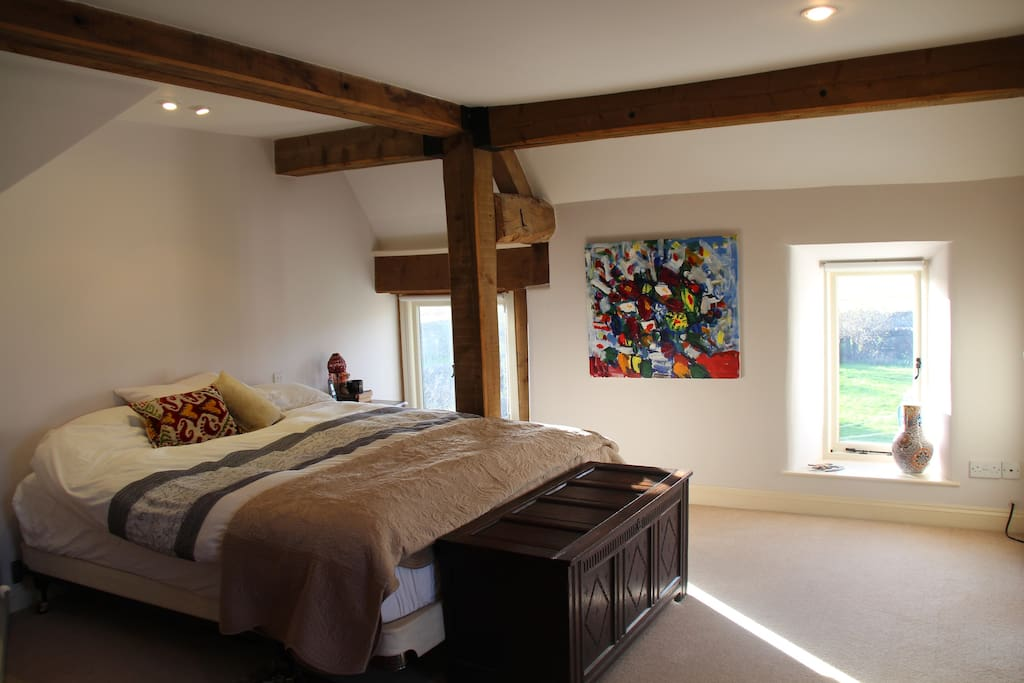 Master bed with beams and very comfy king bed (6ft)