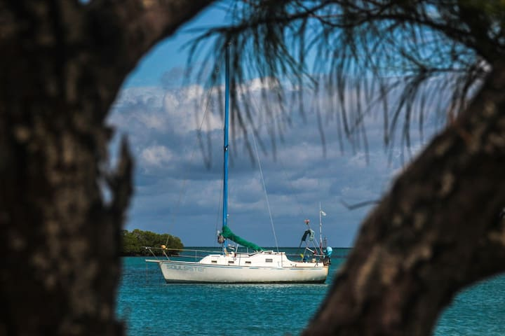 Small Sailboat anchored out at the Cayes of Belize