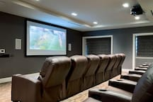 Building amenities: movie room for an extremely comfortable night in.