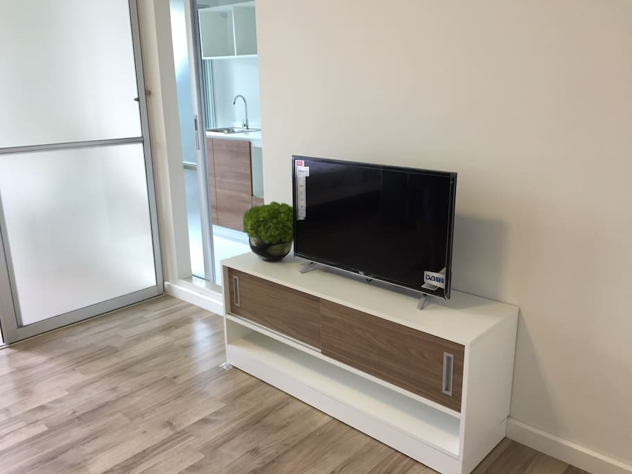 TV set and sliding door to kitchen and bathroom