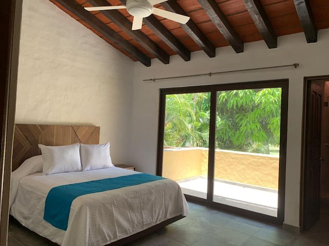 Master Bedroom and balcony overlooking pool and golf course.