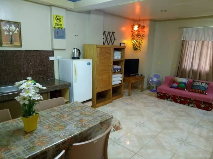 A. Homely Family Room (FREE WiFi + Parking)