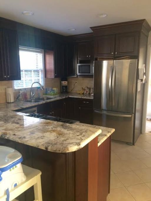 Kitchen with stainless appliances and gas range