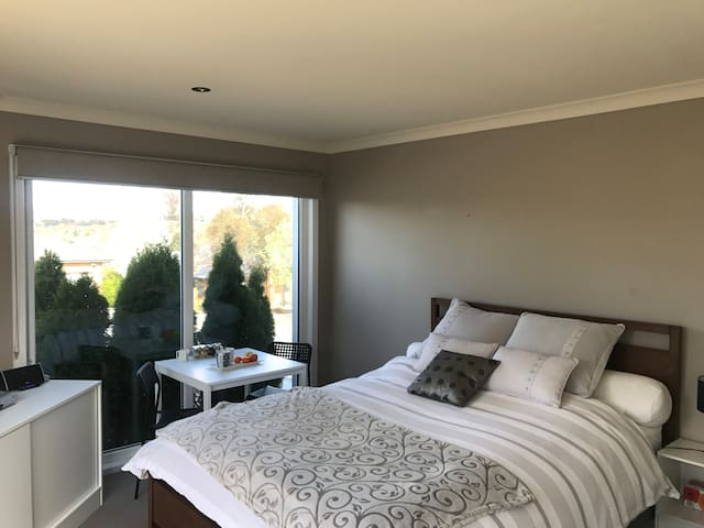 Modern, comfortable, tidy, sunny queen bedroom