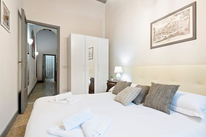 The Bedroom - The comfortable double bed with soft bed- linen and towels