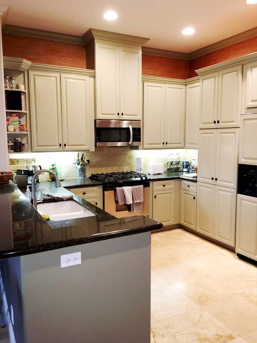 The beautiful kitchen has all new appliances. Feel free to use whatever you need to cook up fabulous meals!
