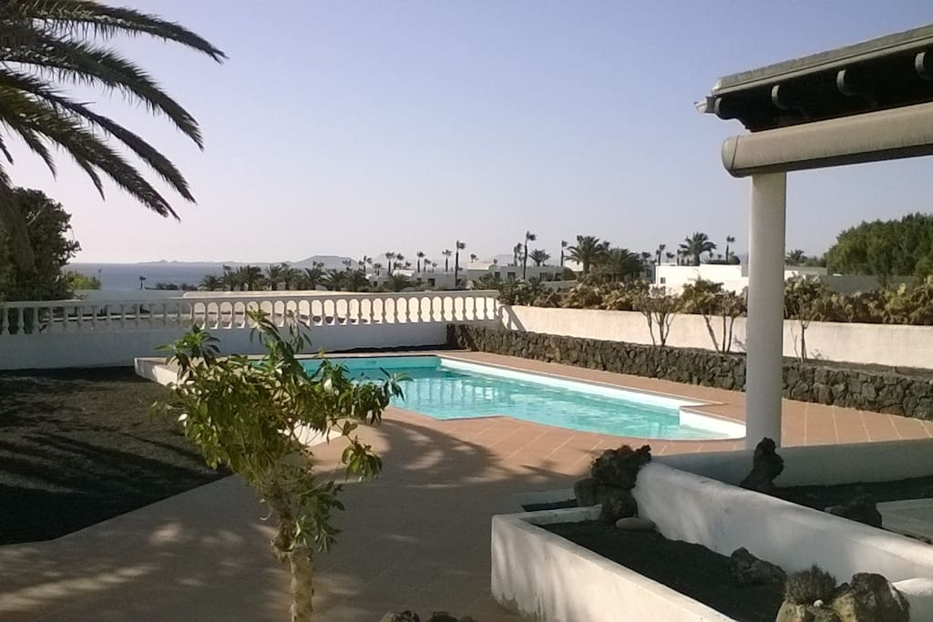 View from garden terrace; sea, harbour and Fuertaventura in the background