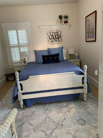 Full size bed across from your private bathroom.