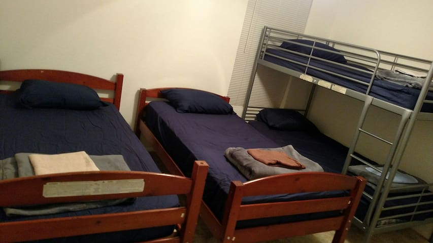 Bunk bed in shared room (orange)